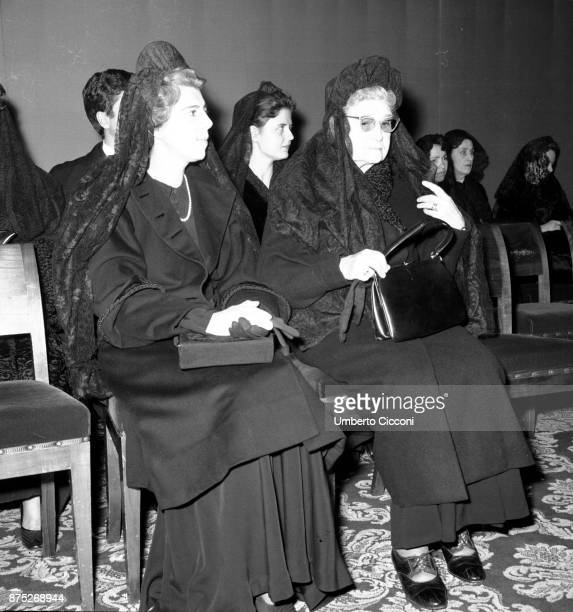 Two women attend the mass celebrated by Pope Paul VI in St Peter's Basilica 1964