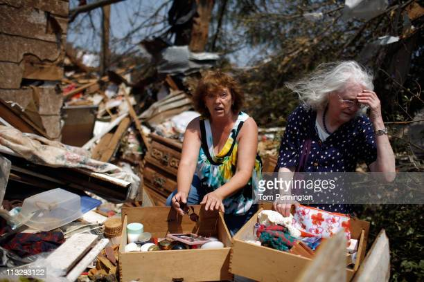 Two women become emotional as they search through a relative's destroyed home on April 30, 2011 in Tuscaloosa, Alabama. Alabama, the hardest-hit of...