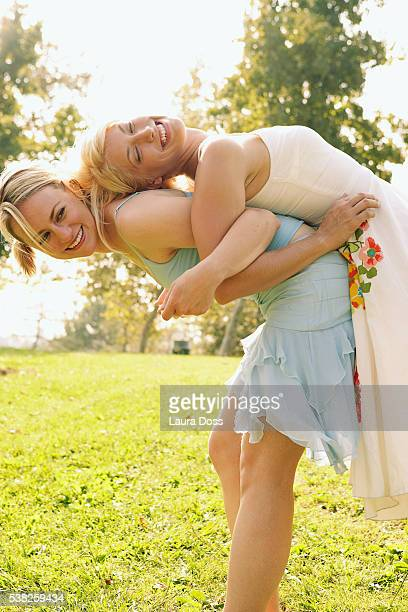 two women being playful - laura belli foto e immagini stock