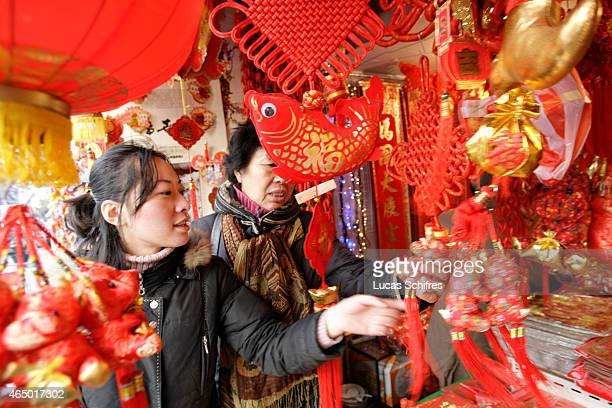 Two women browse decorations for the upcoming Chinese New Year on January 8 2009 in Shanghai China