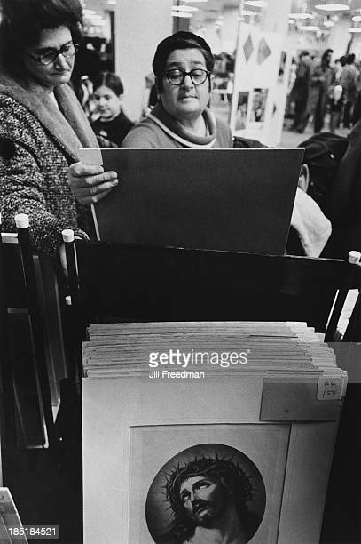 Two women browse through the prints at an art fair in New York City 1970