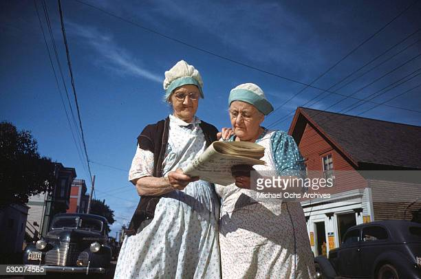 Two women cannery workers read the local paper in Lubec Maine