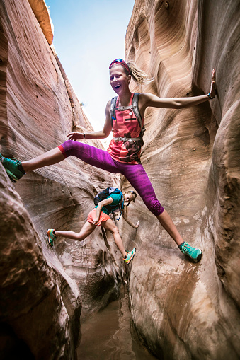 Two women canyoneering through narrow Zebra Canyon, Grand Staircase-Escalante National Monument, Utah, USA - gettyimageskorea