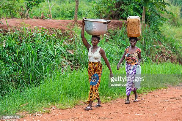two women carrying goods on their heads, dr congo - democratic republic of the congo stock photos and pictures