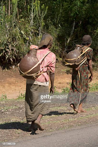 Two women carrying water in Ethiopia