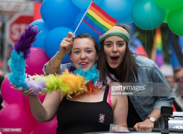 Two women celebrate with a rainbowcoloured flag during the CSDparade in Frankfurt am Main Germany 15 July 2017 Thousands of lesbians and gays take...