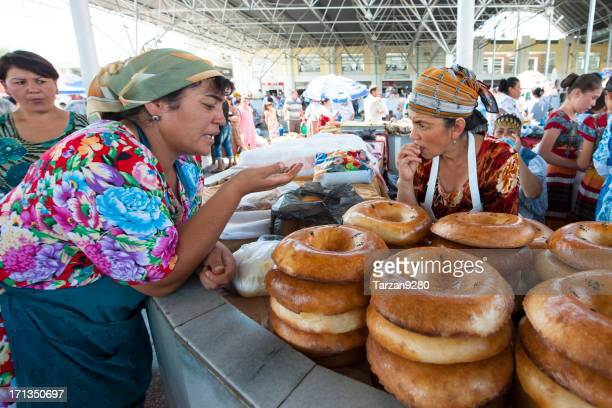 two women chatting on food stand - uzbekistan stock pictures, royalty-free photos & images