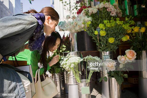 two women choosing flowers from a florist