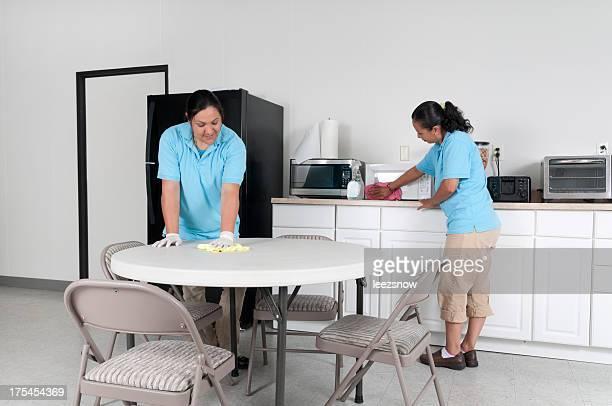 Two Women Cleaning a Corporate Break Room