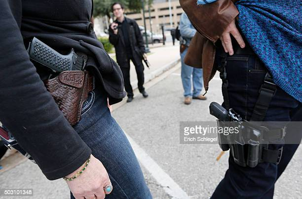 Two women compare handgun holsters during an open carry rally at the Texas State Capitol in Austin Texas On January 1 the open carry law took effect...