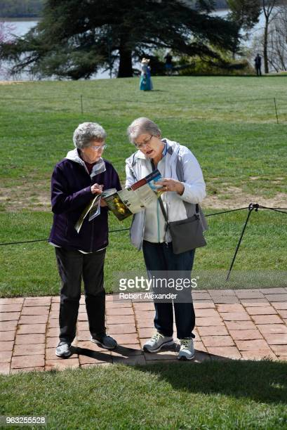 Two women consult a visitors map at Mount Vernon the plantation owned by George Washington the first President of the United States in Fairfax County...