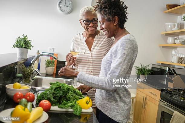 Two women cooking in domestic kitchen