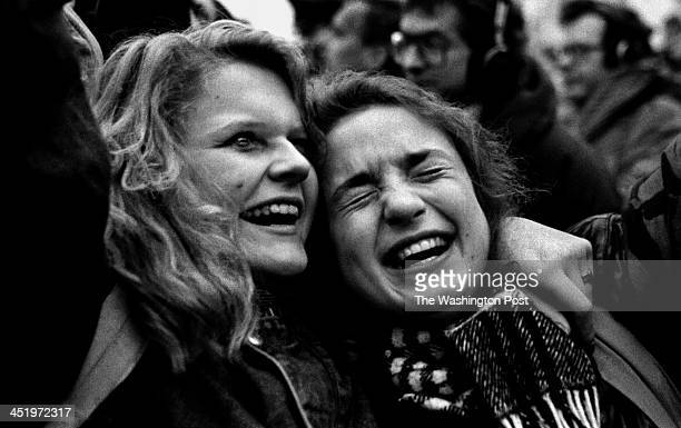 Two women cry tears of joy as they step foot in West Berlin for the first time Photo by Carol Guzy/The Washington Post via Getty Images