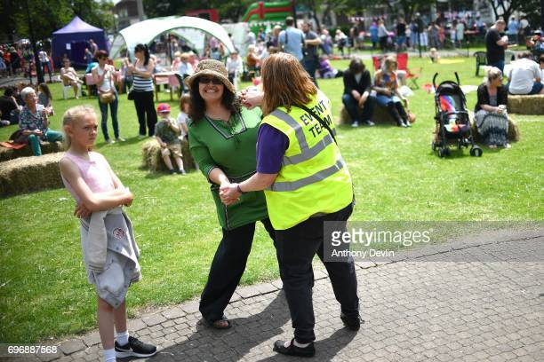 Two women dance as people attend a Great Get Together event in memory of murdered MP Jo Cox on June 17 2017 in Heckmondwike England More than 100000...