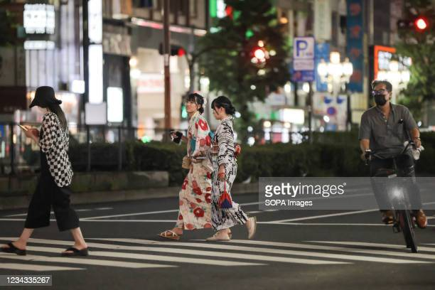Two women dressed in Yukata walk towards Kabukicho, the biggest entertainment district in Tokyo. 3300 people have tested positive for the Novel...