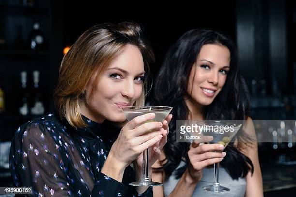 Two women drinking martinis