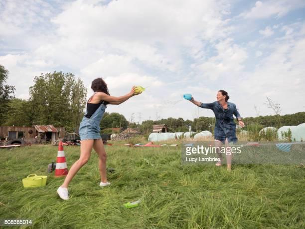 Two women dueling in a water fight
