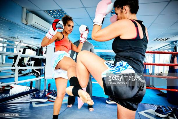 Two women during kickboxing practice