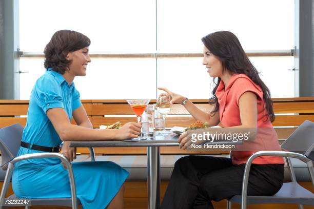 Two women eating at restaurant indoors