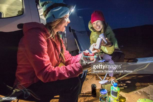 two women eating while camping in desert, hole in the rock road, utah, usa - only mid adult women stock pictures, royalty-free photos & images