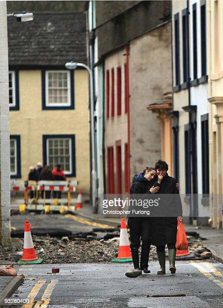 Two women embrace as they return to their flood damaged home on November 21, 2009 in Cockermouth, United Kingdom. A major rescue operation is...