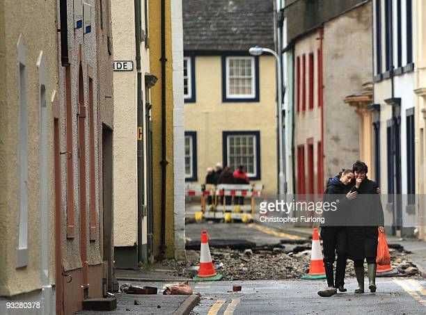 Two women embrace as they return to their flood damaged homes on November 21, 2009 in Cockermouth, United Kingdom. A major rescue operation is...