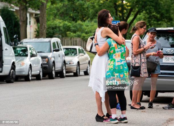 Two women embrace at a makeshift memorial for Justine Damond on July 18 2017 in Minneapolis Minnesota Scrutiny intensified into the death of Justine...