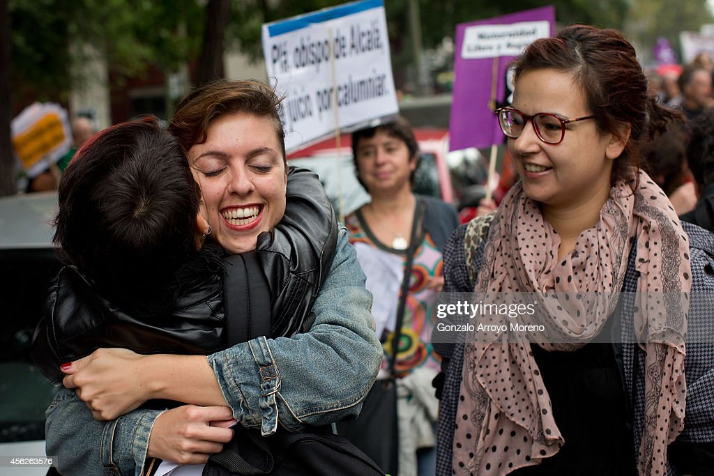 Two women embrace during a demonstration supporting reproductive rights for women on September 28, 2014 in Madrid, Spain. During an international day supporting the decriminalization of abortion, thousands of people have celebrated the Spanish government's new abortion law withdrawal and the resignation of Justice Minister Alberto Ruiz-Gallardon. The protesters are also against Spanish government intentions to restrict the reproductive rights of female teenagers.