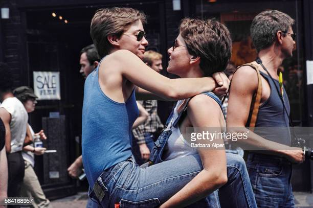 Two women embrace during the Gay Pride parade in New York City USA June 1982