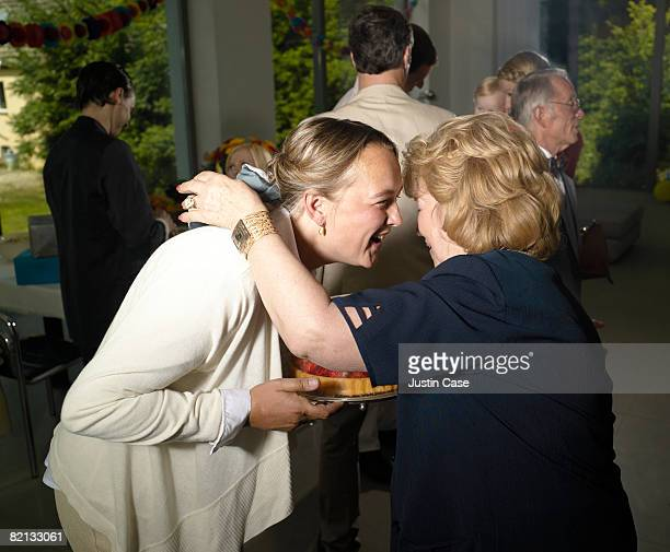 Two women embracing at party