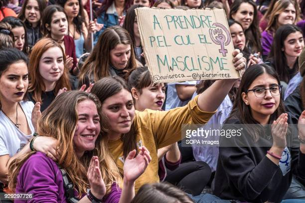 Two women embracing each other seen displaying a sign with the text 'Fuck machismo' More than five million workers support the feminist strike...
