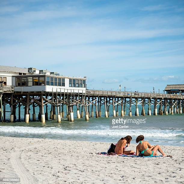 two women at cocoa beach - cocoa beach stock pictures, royalty-free photos & images