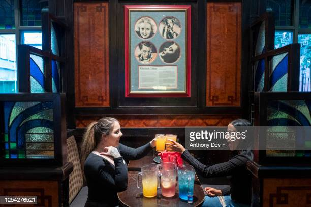 Two women enjoy cocktails at the Regal Moon JD Wetherspoons pub on July 04, 2020 in Rochdale, England. The UK Government announced that Pubs, Hotels...
