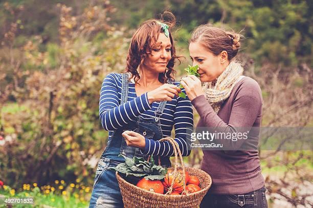 Two Women Enjoying in a Garden
