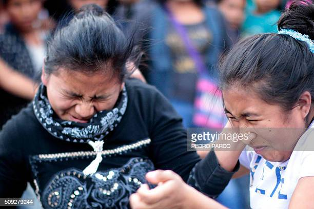 Two women exchange punches a feature of the Xochimilcas fight to defend their women against the Aztecs in the Mexican municipality of Zitlala in...