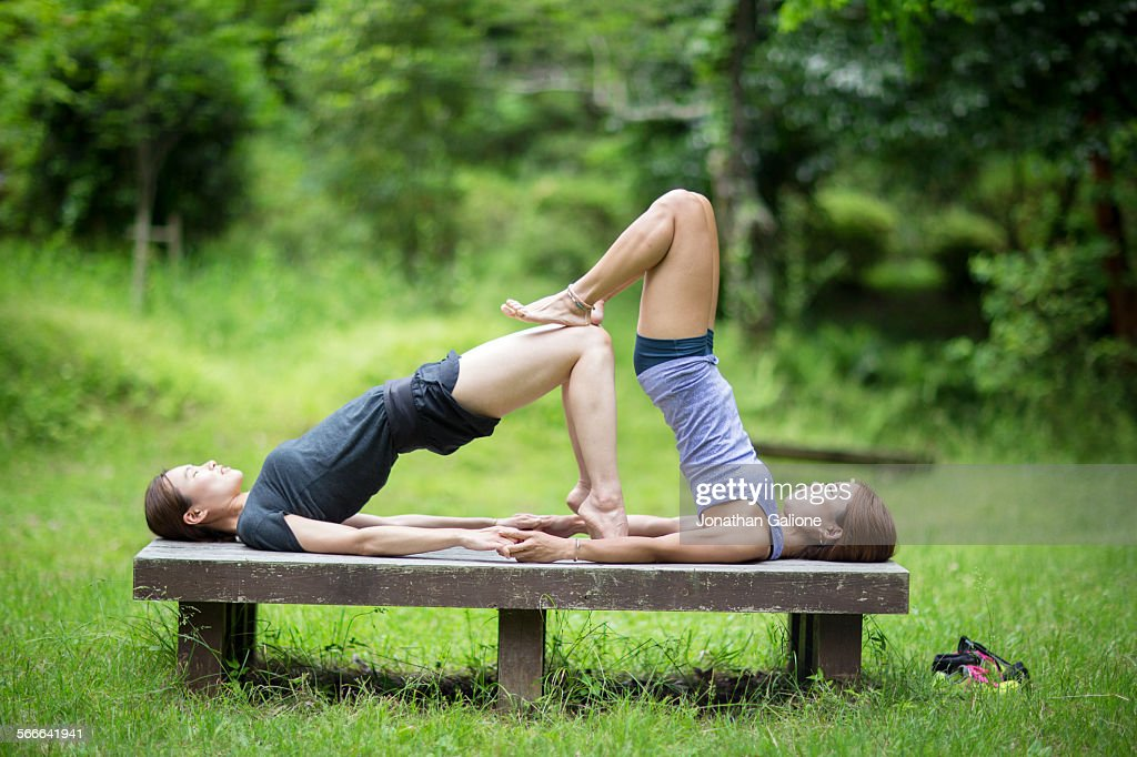 Two women exercising outdoors : Stock Photo