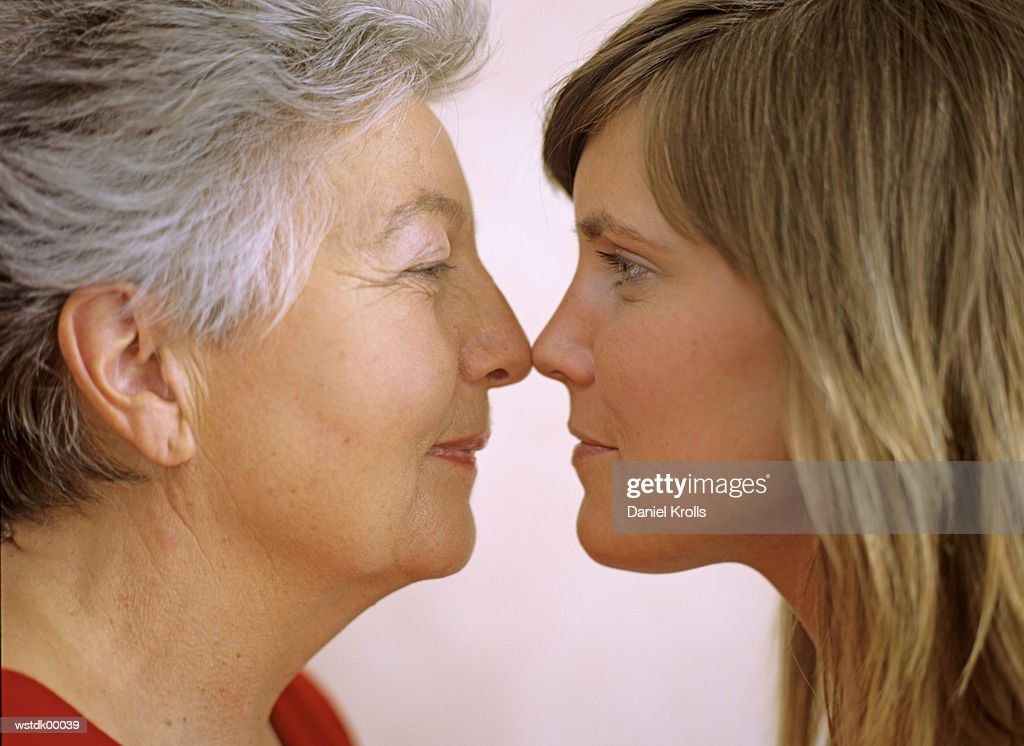 Two women, face to face, close up : Stock Photo