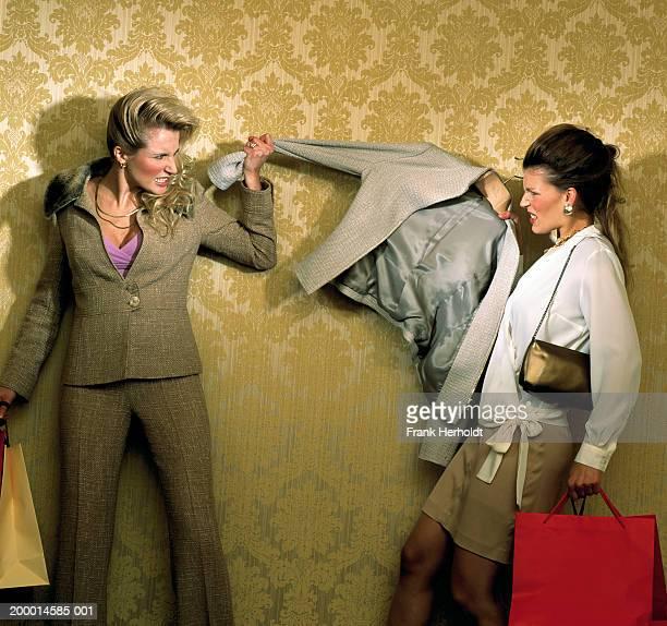 Two women fighting over jacket