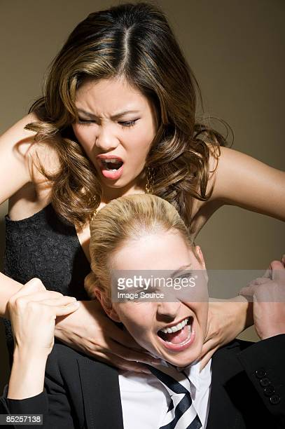 two women fighting - women being strangled stock photos and pictures