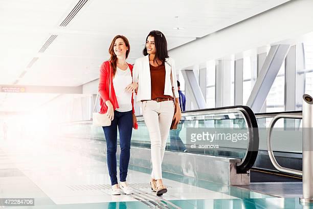 Two Women Friends Walking In Dubai Metro.