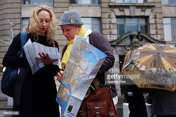 Two women from Australia look at a map of Manhattan on December 21 2011 in New York City Tourism agency NYC Company announced yesterday with Mayor...