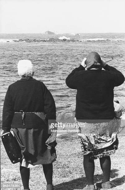 Two women from Portsail watching the wreck of the Very Large Crude Carrier Amoco Cadiz that split tons of oil into the sea causing an environmental...