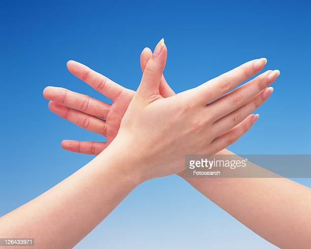 Two women giving a high five to each other