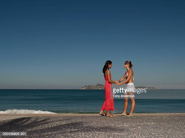 Two women greeting each other on beach