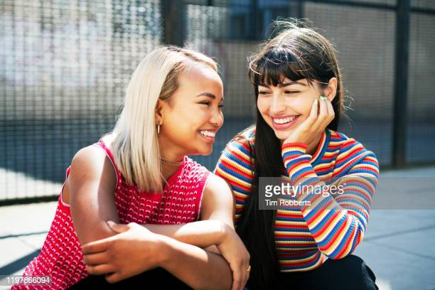 two women hanging out - innocence stock pictures, royalty-free photos & images