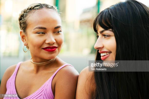 two women hanging out - romantic activity stock pictures, royalty-free photos & images