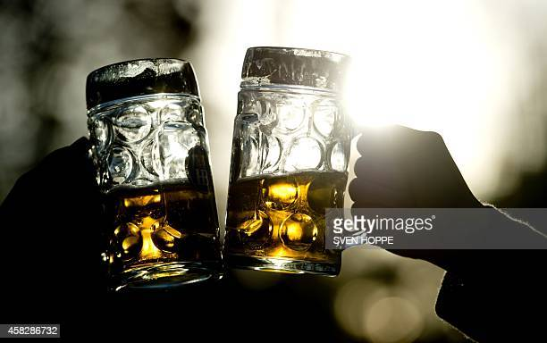 Two women have a beer at a beer garden as the sun shines in Munich southern Germany on November 2 2014 Temperatures are unusually high for this time...