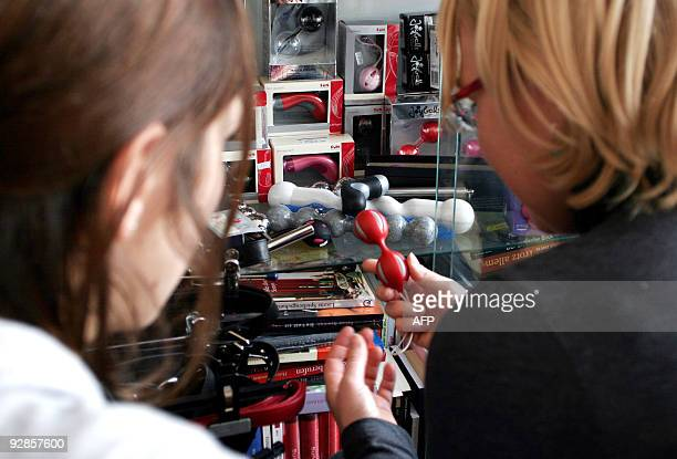 Two women have a look around in a 'sex toy' shop for women in Berlin on November 6 2009 Laura Meritt owner of the 'sex toy' shop for women and...