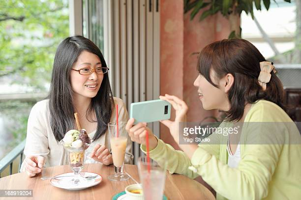 Two women having a chat in a cafe