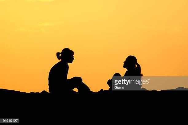 Two women having a friendly chat outside